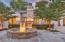 imported stone fountain and another outdoor fireplace