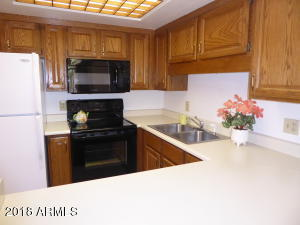 Well thought out U shaped kitchen has all the appliances you'll need in a convenient space.