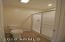 Master bathroom - new Kohler toilet, vent fan/light, and Delta shower system