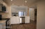 New white shaker-style cabinets, quartz counter tops, stainless appliances, sink, faucet and disposal.