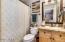 Full Bath Downstairs, Granite Counter, Custom Mirror, Upgraded Light & Plumbing Fixtures