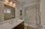 Bedroom 2 in suite bath with large walk in shower, porcelain tile