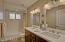 Double Vanities, mirrors, lighting and rectangular sinks with drawer storage in cabinet