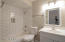 Guest Bathroom with subway tile surround and new everything