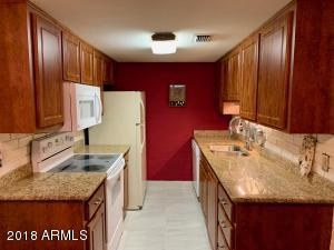 Newly renovated Kitchen with newer cabinets, Updated granite and Stainless Sink.
