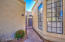 Private gated front courtyard