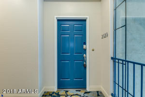 This 2 bedroom, 2 bathroom condominium sits with a beautiful north facing view of greenery and lush trees. Located minutes from Sky Harbor International Airport, minutes from the prized Arcadia neighborhood with fantastic restaurants and shopping, this lock and leave, turnkey abode offers resort-like living with a community pool, gym, and lush landscaping. The kitchen opens seamlessly to the living and dining area, perfect for entertaining friends and family. The master bedroom features a large walk-in closet, dual vanity sinks, a large soaker tub and shower. Welcome home