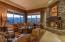 Enjoy spectacular golf course and mountain views from great room with custom fireplace.