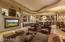 Open floor plan with full wet bar and eat-in kitchen.