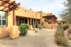 BACK YARD W/ DESERT LANDSCAPING MAINTAINED BY HOA