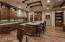 The Gourmet Kitchen offers top of the line appliances, a huge center island, custom cabinetry, granite counters and custom tile backsplash.