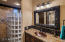 All bathrooms have been remodeled with granite counters, copper sinks, framed mirrors and custom light fixtures.