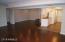 Living Room looking back to front door/kitchen/formal dining-bonus area
