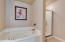 Master bath with large jetted tub and walk-in shower
