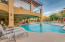Sit by the pool or on the deck over looking the pool.