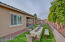Backyard Retaining Wall w/ Privacy Trees, Fire Pit, Covered Patio and BBQ Outdoor Kithen