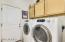 THE LAUNDRY ROOM HAS CABINETRY AND NEWER FRONT LOADING MACHINES INCLUDED I N THE SALE.