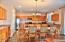 Spacious, Light & Bright Eat-In Kitchen With Lots of Cabinet Storage and Countertop For Workspace.