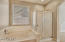Separate walk-in shower and bath tub in the master bathroom.