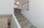Custom hand-sanded steel tubing on stairway