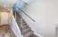 Custom hand-sanded steel tubing on stairway