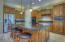 Pendant lighting accents the chiseled edge granite counter