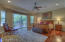 Huge Master Suite features wood flooring & separate exit to backyard