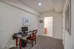 Rare & very desirable 1 Bedroom, 1.5 Bathroom + Den floor plan! This beautiful unit has views of one of the beautiful sparkling outdoor pools at Optima Camelview with a south facing patio exposure. Here you can enjoy the spacious patio surrounded by lush greenery while enjoying all that Optima offers! Kitchen design is excellent for entertainers and opens up to the bright and light living room space! All found within the luxurious Optima Camelview!Optima Camelview Village has an unbeatable location and the community features concierge service, gated parking, party room w/caterer kitchen, Fitness Center, His and her Locker/Steam rooms, Indoor Pool & Spa, 2 Outdoor Zen Pools & Spas, Racquetball/Basketball courts, putting green, dog park, onsite restaurant + more