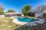 Beautiful Diving Pool and grassy backyard with mature landscaping.