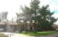 Beautiful neighborhood with many yards with green grass & mature trees