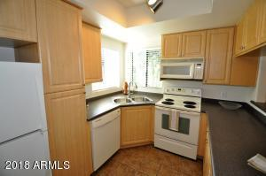 Full Kitchen with Microwave, Dishwasher, Range/Oven, & Refrigerator.