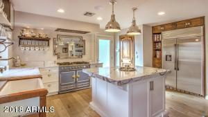 The Herbeau French sink & stand is accentuated with a Rohl faucet. The kitchen is also equipped with a Kenmore Pro-built oversized refrigerator/freezer