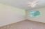 Large master bedroom has plenty of room for a king bed and sitting area