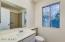 Private master bathroom with tiled walk-in shower