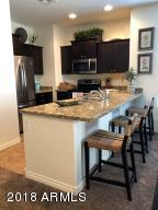 KITCHEN HAS GRANITE COUNTERS AND STAINLESS STEEL APPLIANCES AND SOFT CLOSE CABINETS/DRAWERS