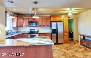 Great kitchen with pendant lighting and newer cabinets