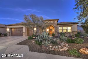 Low maintenance landscaped front yard with stunning brick trim on the home.