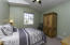 LARGE UPSTAIRS GUEST BEDROOM W/WALK-IN CLOSET, VAULTED CEILINGS.
