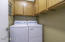 INDOOR LAUNDRY W/ CONVENIENT HIDE-AWAY LAUNDRY CHUTE IN CABINET