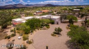 There's a large motorcourt entry to the home which has a prime Skyranch runway location and borders the Desert Forest Golf Course.