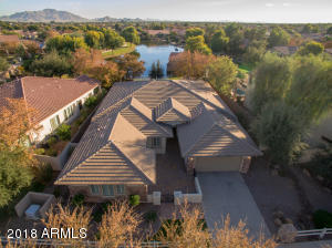 Aerial view of this beautiful former model home shows the fabulous waterfront lot in Old Stone Ranch.
