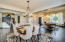 Expansive living/dining room with gorgeous new wood flooring.