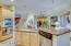 Large kitchen boast double oven, stainless steel appliances and granite counter tops!