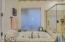 Master bath features separate shower/tub & his/her sinks and a large walk in closest with ample storage space.