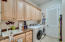 Large laundry room located downstairs.