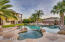 Backyard oasis with sparkling pool and spa, fire pit and built in grill and more!