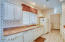 Guest house galley style kitchen with granite counters!