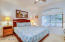 Guest house master suite with en suite bath featuring walk in shower and over sized walk in closet!