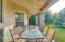Guest house backyard space boasting lush green grass, covered patio and fruit trees!