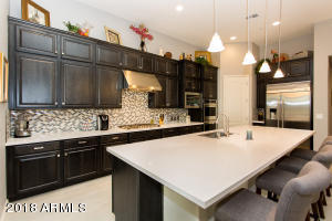 Monogram deluxe appliances, quartz top, custom finish cabinetry